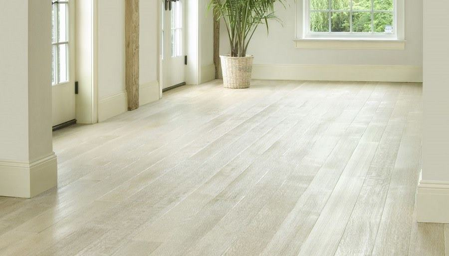 is the wooden of  parquet better  or Laminate?